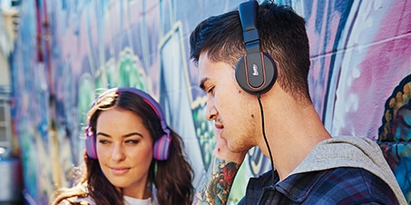 Fuse Audio Girl And Guy Wearing Headphones